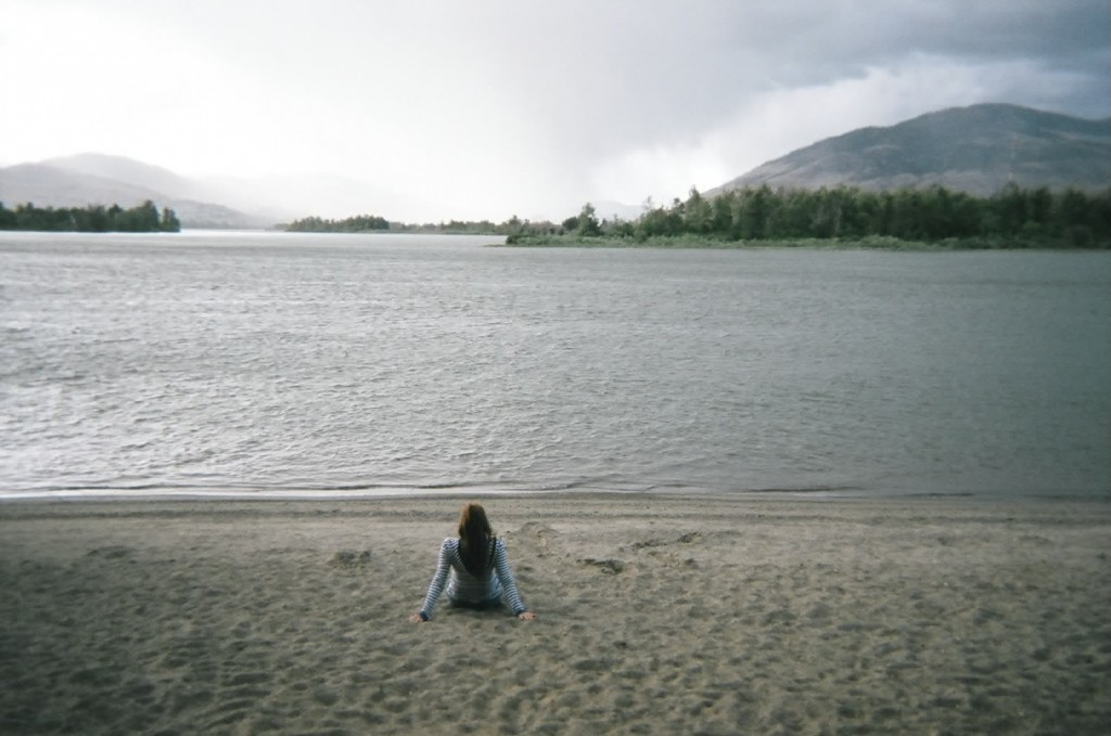 This is me sitting at Riverside Park near the beach in front of the river. It means to come to Kamloops and to have peace, of so many things, so many things. It was a new start, so it was something new